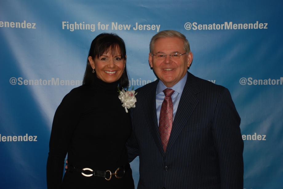 Senator Menendez and recipient Aida Marcial.