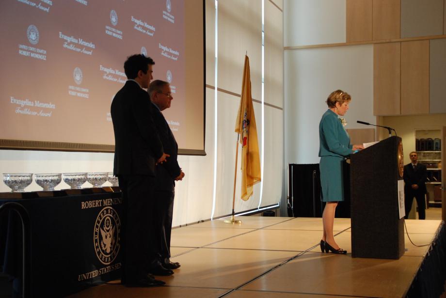Award recipient Kathleen Assini speaks.