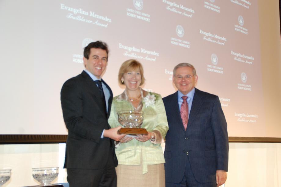 Amy Mansue receives her award.