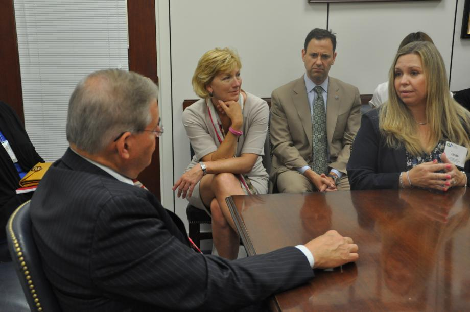 Sen. Menendez hears from Linda Salvetti, the mother of a patient at Children's Specialized Hospital.