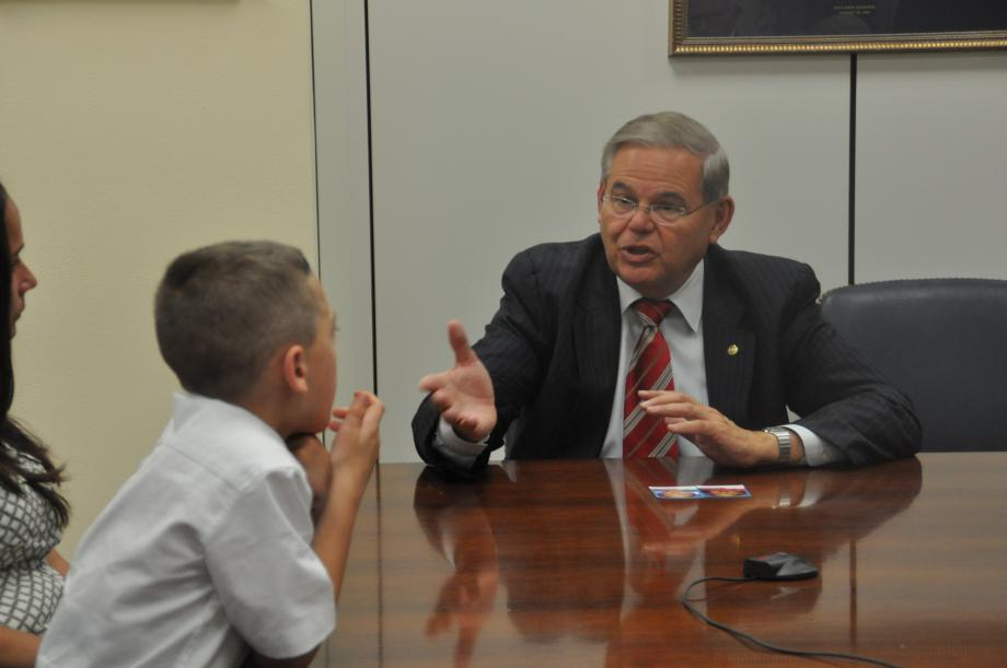 Sen. Menendez talks to Christopher Ennis and his family.