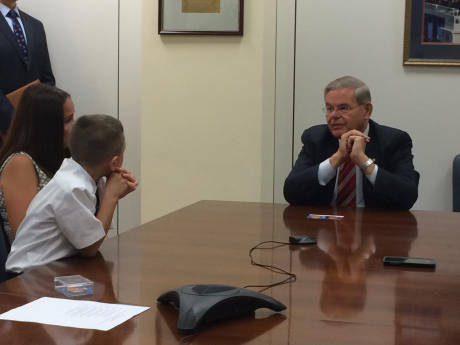 Sen. Menendez talks to Christopher Ennis and his family about children's health care.
