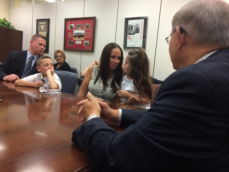 The Ennis family supports one another, as they tell their story to Sen. Menendez.
