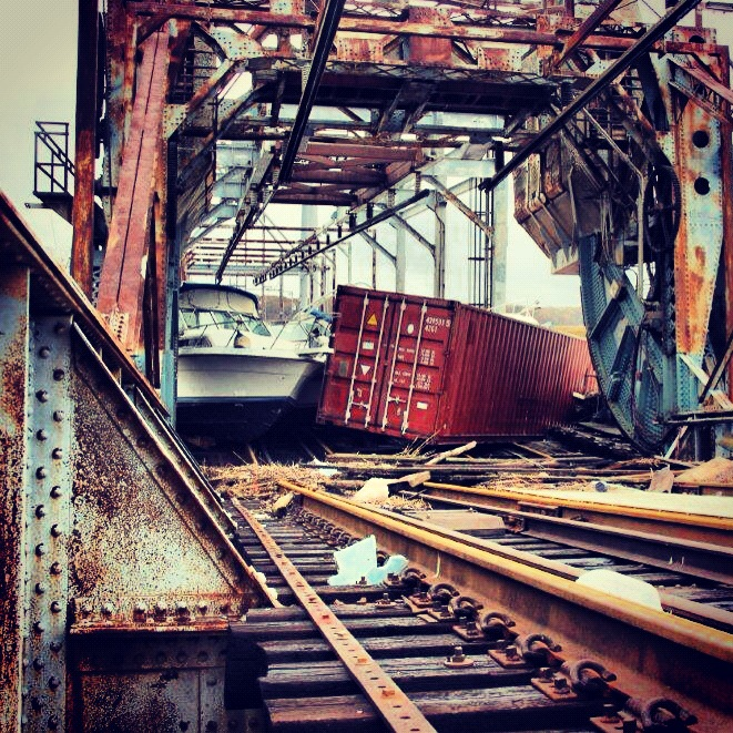 PHOTO NUMBER 1. Container and boat on tracks.