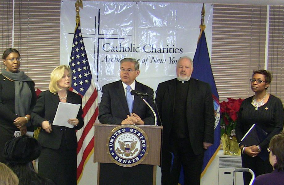 Senator Menendez speaking in support of taking additional federal steps to expedite the adoption of orphans in Haiti (New York City, NY)