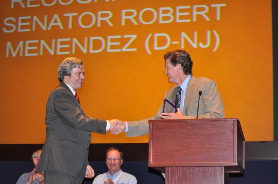 Hal Connolly receiving the award on behalf of the Senator