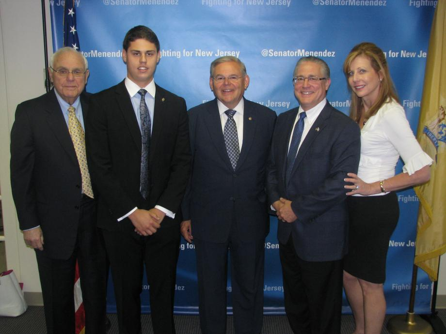 Sen. Menendez with Joseph C. Shavel of Pennington, who was accepted into the U.S. Naval Academy, and guests