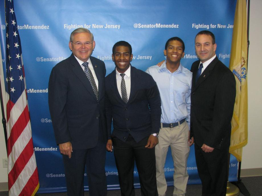 Sen. Menendez with Miloody Vincent of Irvington, who was accepted into the U.S. Naval Academy Preparatory School, and guests