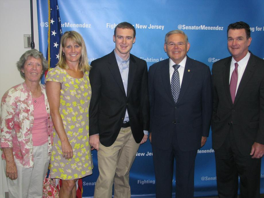 Sen. Menendez with Tate Bowers of Montclair, who was accepted into the U.S. Military Academy at West Point, and guests