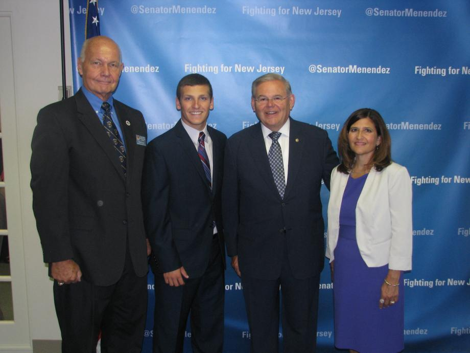 Sen. Menendez with Eric Rainear of Buena, who was accepted into the U.S. Merchant Marine Academy, and guests
