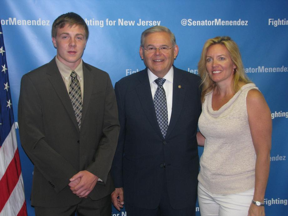 Sen. Menendez with Michael Mischler of Monroe Township, who was accepted into the U.S. Merchant Marine Academy Preparatory Program, and a guest