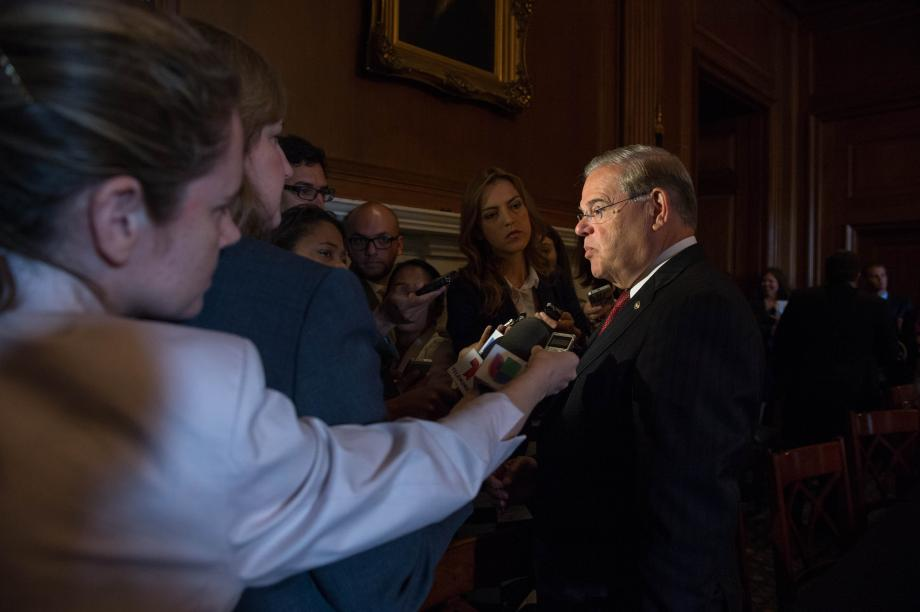 Sen. Menendez answers reporter questions after the media roundtable.